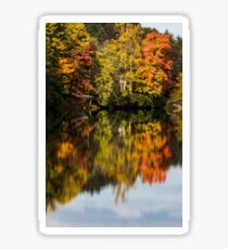 Reflection of fall foliage in a lake Sticker