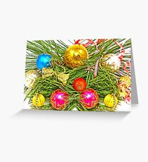 Multicolored Christmas balls and pine branch. Greeting Card