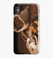 Coffee cup with cinnamon, star anise and dried orange fruit iPhone Case