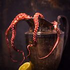Not-so-still life with octopus and pitcher by alan shapiro