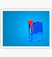 Valentines Day holiday gift bag and red heart on blue. Sticker
