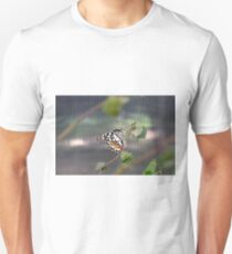 Beautiful colorful butterfly in the garden  T-Shirt