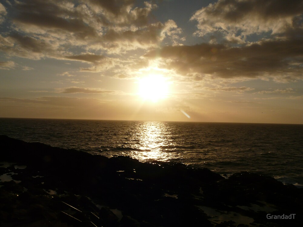 Sunset over Peel - Isle of Man by GrandadT