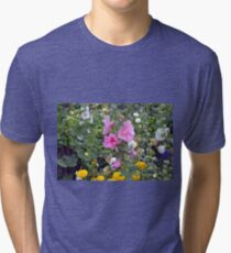 Colorful small flowers in the garden  Tri-blend T-Shirt