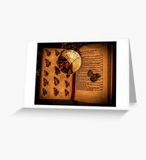 Butterfly wings book under the magnifying loop Greeting Card