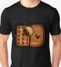 Butterfly wings book under the magnifying loop T-Shirt