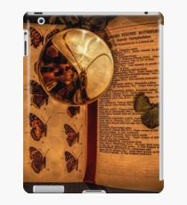 Butterfly wings book under the magnifying loop iPad Case/Skin