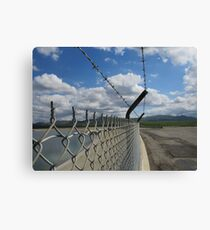 Barbed wire and sky Canvas Print