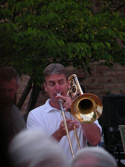 sly trombone player by WonderlandGlass