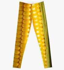 Three corn ears. Vegetable concept background Leggings