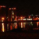 water front at night by Brodyn  Beveridge