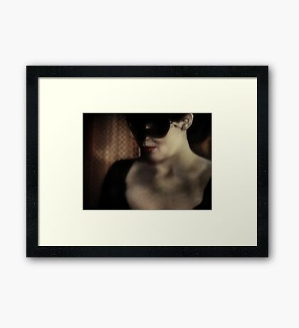 Woman In A Black Mask Framed Print