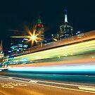 Passing Tram by Ewan Arnolda
