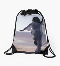 Woman practicing Tai Chi at sunset outdoorsa art print Drawstring Bag