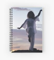 Woman practicing Tai Chi at sunset outdoorsa art print Spiral Notebook