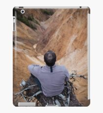Sitting on the edge of a cliff iPad Case/Skin