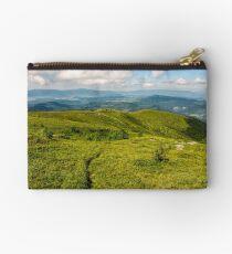 footpath through grassy mountain meadow Studio Pouch
