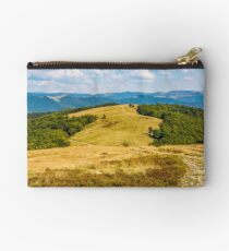 landscape with alpine meadow and mountain ridge Studio Pouch