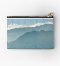 clouds rising behind the blue mountain Studio Pouch