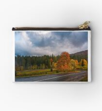 colorful foliage on serpentine in rainy fall weather Studio Pouch