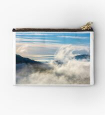 thick cloud formation rising from the valley Studio Pouch