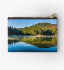 smokey lake reflect forest mountain and blue sky Studio Pouch