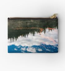 foliage on the water reflecting forest and sky Studio Pouch