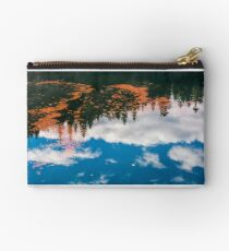 foliage on the water reflecting forest and cloud Studio Pouch
