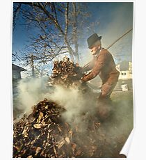 Old farmer burning dead leaves Poster