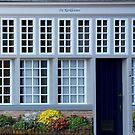 De kerkleuner ( House leaning against the church ) by Arie Koene