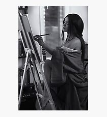 Woman artist in red painting on easel in her home studio Black and white art print Photographic Print