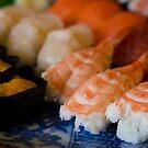 Nigiri Sushi on a Blue Plate by Skye Hohmann