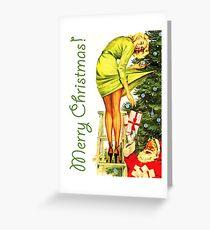 Pin up woman decorates Christmas tree with Santa Greeting Card