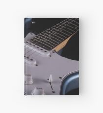 Electric guitar on wooden background, close up Hardcover Journal