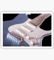 Electric guitar on wooden background, close up Sticker