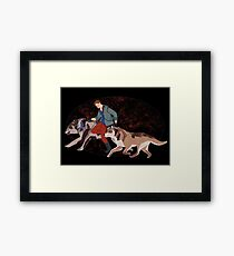 The boy who runs with wolves Framed Print