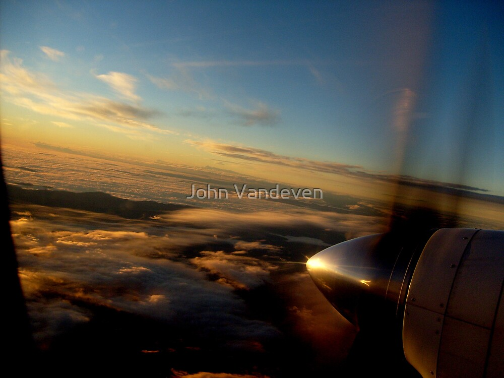 Smooth flight into the sunrise by John Vandeven