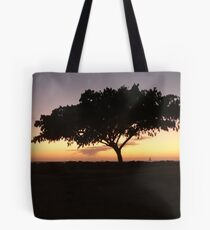 silhouette on the breakwater at sunset Tote Bag