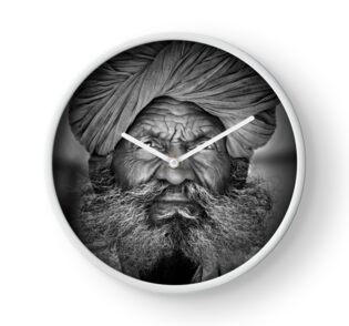 Old Rajasthani Man - Clock by Glen Allison