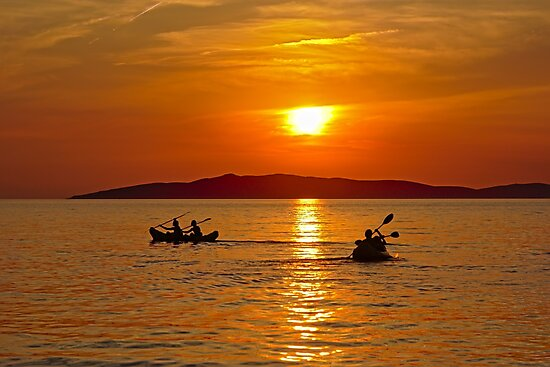 Canoes in the adriatic sea during sunset by xophotography