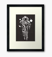 Bicycling Astronaut Framed Print