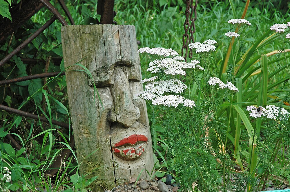Red Lipped Indian Totem Among White Wildflowers by pjwuebker