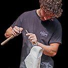 Sculptor at work. by John Thurgood