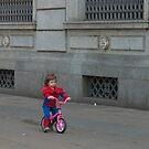 A child on a bicycle. by Lanii  Douglas