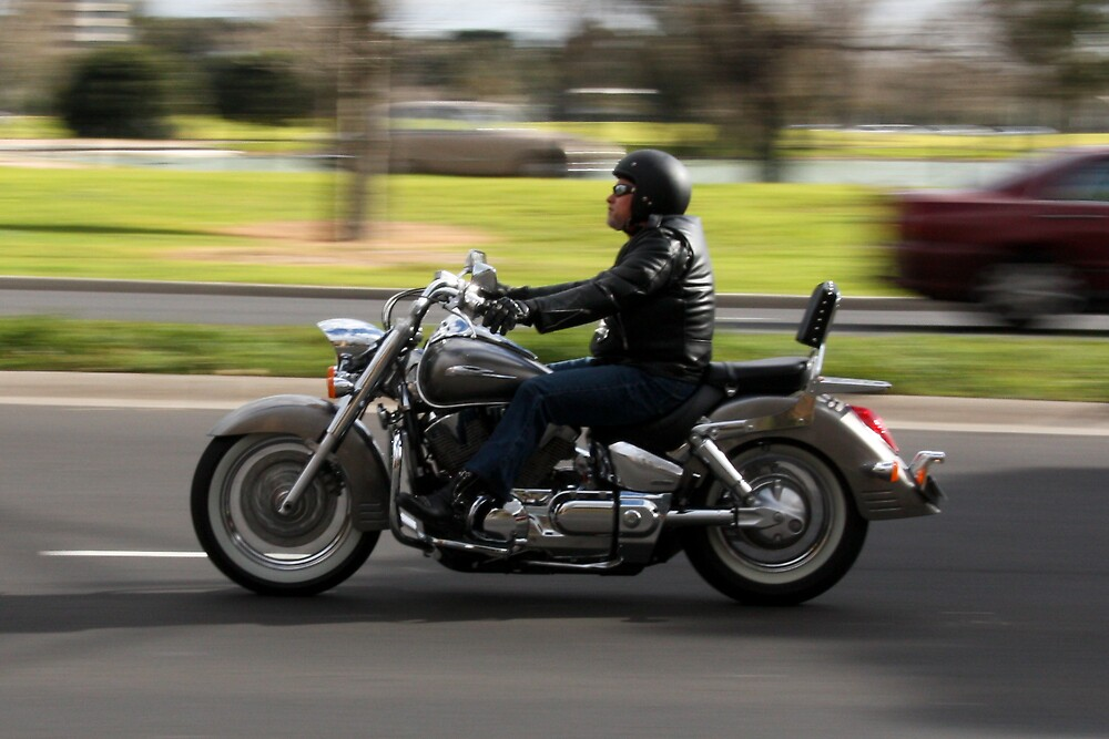 Panning shot of bikie by Allan Lay