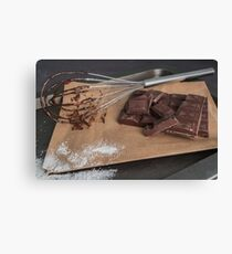 Chocolate chunks. Chocolate bar pieces and whisk on board Canvas Print