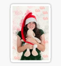 Digitally enhanced image of a Young teen wearing Santa's helper hat and hugging a stuffed Teddy bear with Christmas atmosphere  Sticker