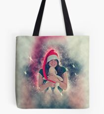 Digitally enhanced image of a Young teen wearing Santa's helper hat and hugging a stuffed Teddy bear with Christmas atmosphere  Tote Bag