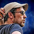 A man and his cap by Kurt  Tutschek