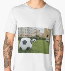 soccer balls on the green lawn Men's Premium T-Shirt